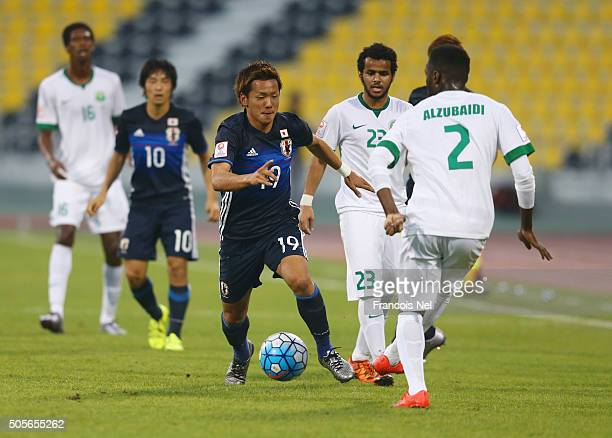 Ali Alzubaidi of Saudi Arabia is closed down by Yosuke Ideguchi of Japan during the AFC U23 Championship Group B match between Saudi Arabia and...