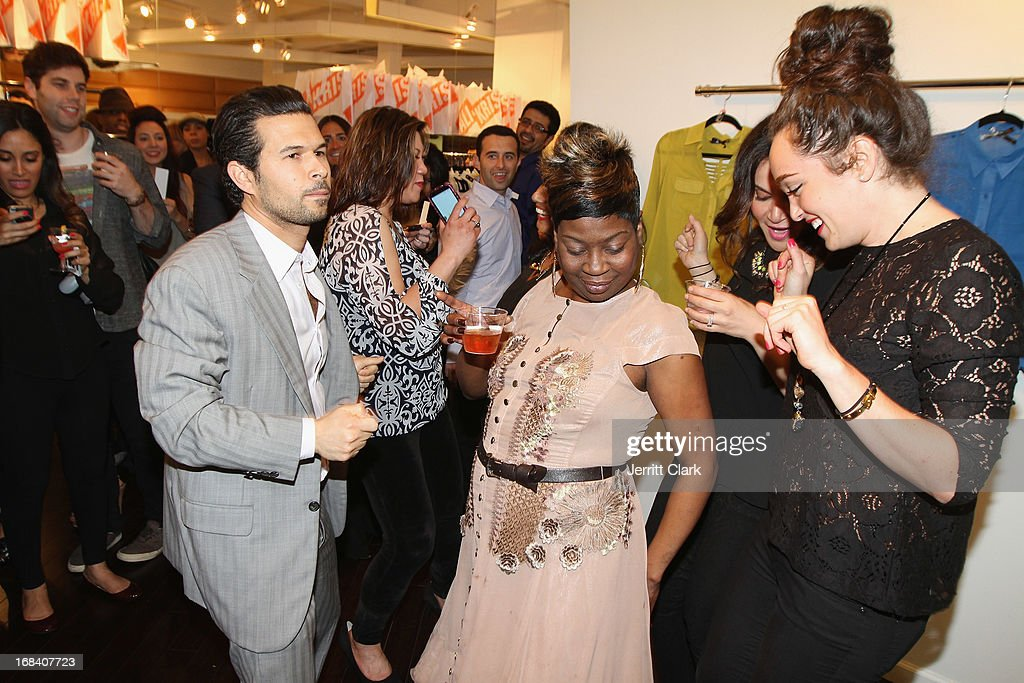 Ali and Kris owner Jason Hoffman dances with Sweet Brown at the Reality Runway By Ali And Kris at the Ali and Kris Showroom on May 8, 2013 in New York City.