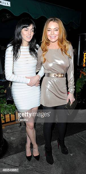 Ali and Lindsay Lohan attend the LOVE x Balmain Chrismas Party at The Ivy Market Grill on December 15 2014 in London England