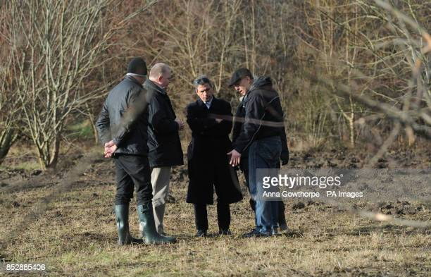 Ali Aydi the uncle of murdered Rania Alayed talks to DCI Peter Marsh and his friend and translator Mohammed Muflih as they look at land near a layby...