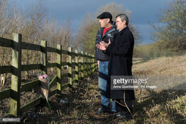 Ali Aydi the uncle of murdered Rania Alayed with his friend and translator Mohammed Muflih prays after he lays flowers at a layby alongside the A19...