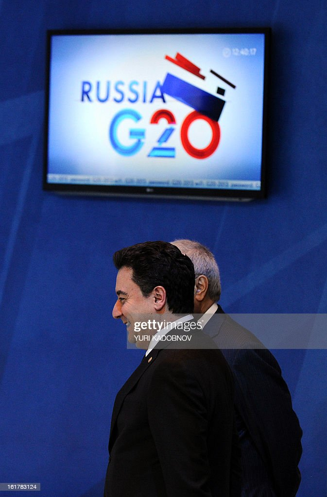 Ali Babacan Deputy Prime Minister for Economic and Financial Affairs of Turkey walks after G20 states finance ministers and central bank governors meeting in Moscow, on February 16, 2013. The ministers and central bank governors gathered today in Moscow for their first meeting in the Russian capital aimed at reassuring markets that the world's economic powers would not slug it out in 'currency wars' to boost national growth. AFP HOTO/YURI KADOBNOV