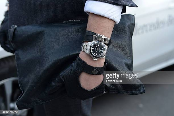 Ali Bayramoglu poses wearing glove by Que watch by Rolex and hand bag by Givency during Mercedes Benz Fashion Week Istanbul FW15 on March 19 2015 in...