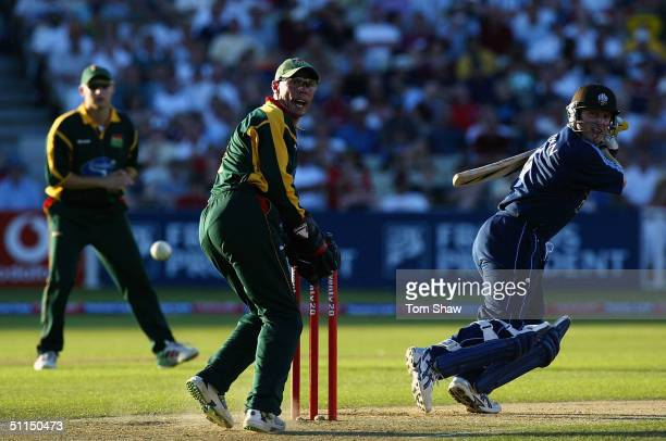 Ali Brown of Surrey hits out during the Surrey v Leicestershire Twenty20 cup Final match at Edgbaston Cricket Ground on August 7 2004 in Birmingham...