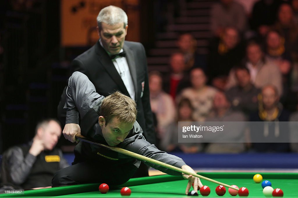 <a gi-track='captionPersonalityLinkClicked' href=/galleries/search?phrase=Ali+Carter&family=editorial&specificpeople=684764 ng-click='$event.stopPropagation()'>Ali Carter</a> of England in action during his first round match against John Higgins of Scotland at Alexandra Palace on January 14, 2013 in London, England.
