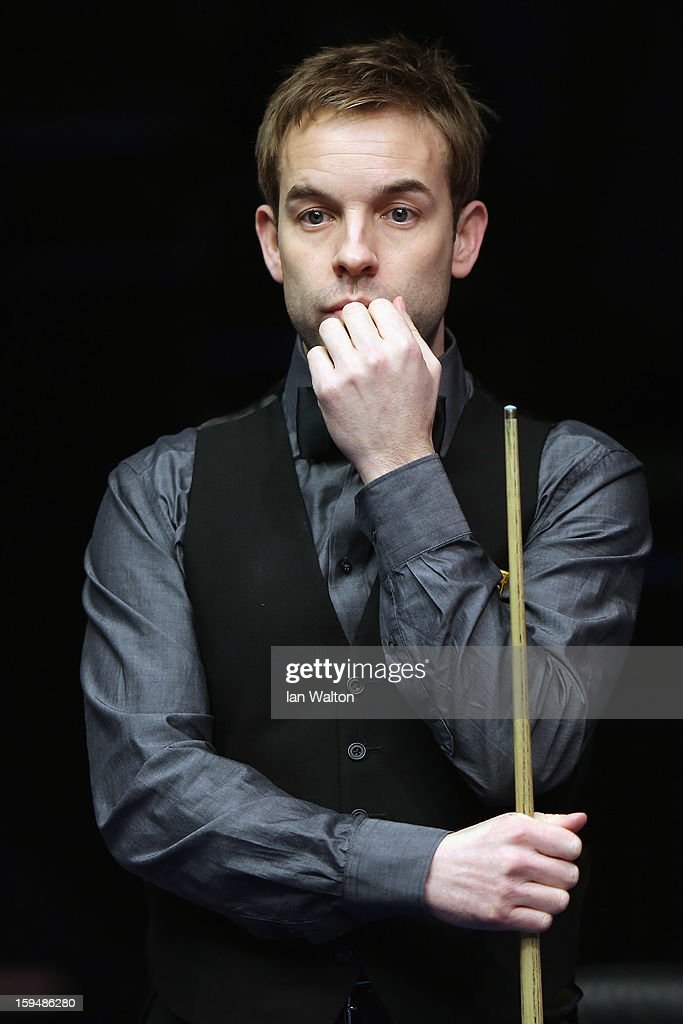 <a gi-track='captionPersonalityLinkClicked' href=/galleries/search?phrase=Ali+Carter&family=editorial&specificpeople=684764 ng-click='$event.stopPropagation()'>Ali Carter</a> of England looks on during his first round match against John Higgins of Scotland at Alexandra Palace on January 14, 2013 in London, England.