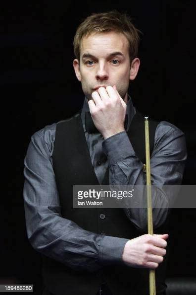 Ali Carter of England looks on during his first round match against John Higgins of Scotland at Alexandra Palace on January 14 2013 in London England