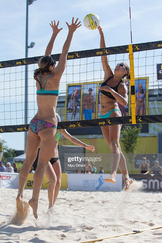 Ali Daley (L) spikes the ball against Sheila Shaw (R) as Brittnay Hochevar (M) looks on at the 2014 AVP Cincinnati Open on August 29, 2014 at the Lindner Family Tennis Center in Cincinnati, Ohio.