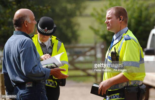 Ali Demin left a goose farmer and owner of Goosefayre sited at Hardwick Park near Lyne Surrey talking to police at the entrance to his property His...