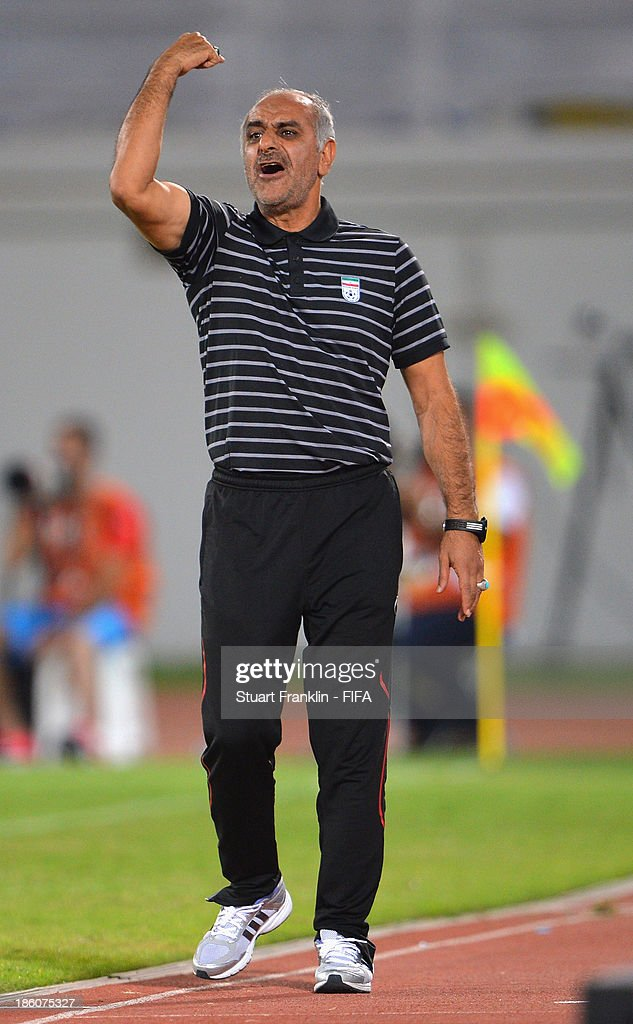 Ali Doustimehr, head coach of Iran U17 team gestures during the FIFA U 17 World Cup group E match between Austria and Iran at Khalifa Bin Zayed Stadium on October 25, 2013 in Al Ain, United Arab Emirates.