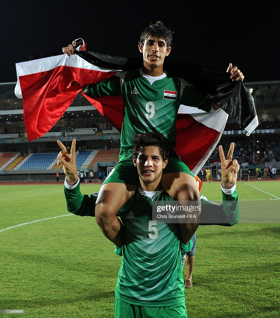 Ali Faez of Iraq carries team-mate Mahdi Kamil on his shoulders following the FIFA U20 World Cup Round of 16 match between Iraq and Paraguay at Akdeniz University Stadium on July 03, 2013 in Antalya, Turkey.