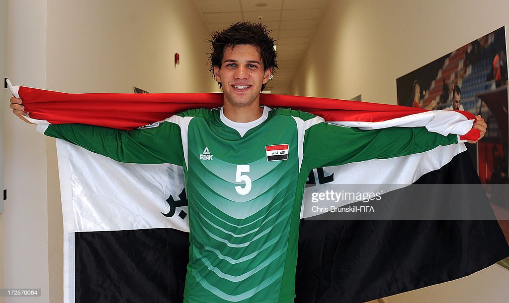 Ali Faez of Iraq celebrates in the dressing room at full-time following the FIFA U20 World Cup Round of 16 match between Iraq and Paraguay at Akdeniz University Stadium on July 03, 2013 in Antalya, Turkey.