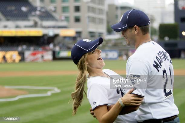 ACCESS** Ali Fedotowsky and Roberto Martinez throw out the first pitch at the Padres Game on August 27 2010 in San Diego California Ali wore Alex...