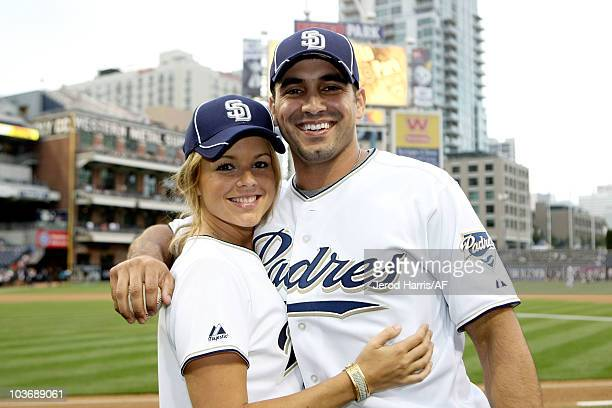 ACCESS** Ali Fedotowsky and Roberto Martinez throw out the first pitch at the Padres Game on August 27 2010 in San Diego California