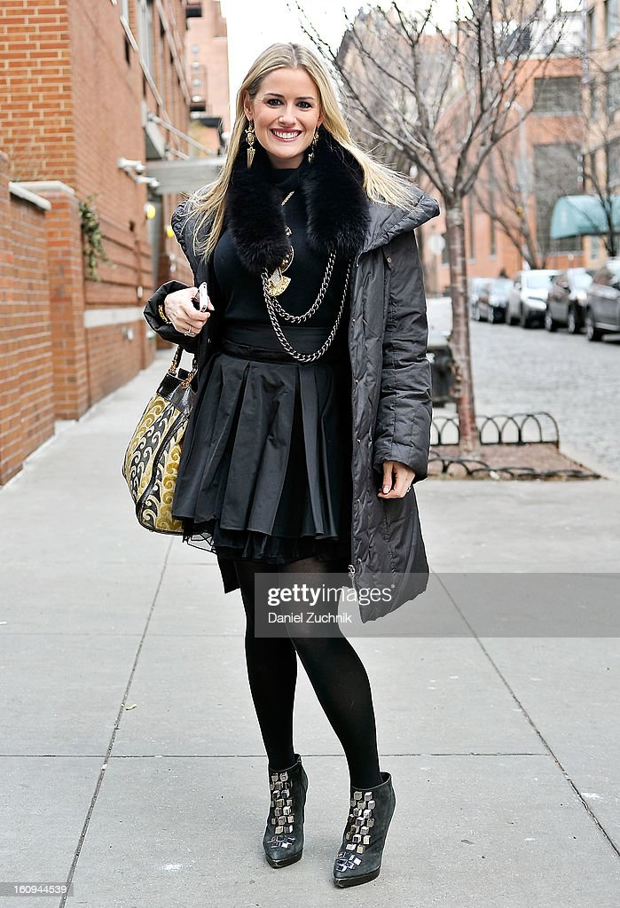 Ali Galgano, founder of charmandchain.com, seen outside the Dannijo jewelry presentation wearing a Theory sweater, Elizabeth and James skirt, Pierre Hardy booties, Kara Ross necklace, Lulu Frost earrings with a Miu Miu bag on February 7, 2013 in New York City.