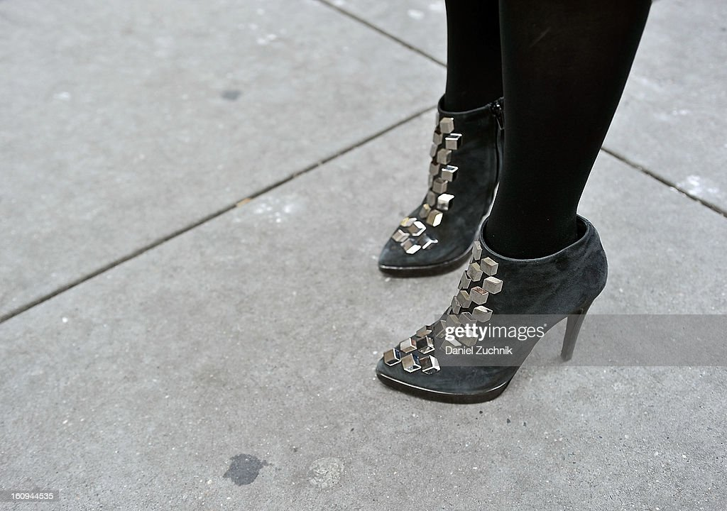 Ali Galgano, founder of charmandchain.com, seen outside the Dannijo jewelry presentation wearing Pierre Hardy booties on February 7, 2013 in New York City.