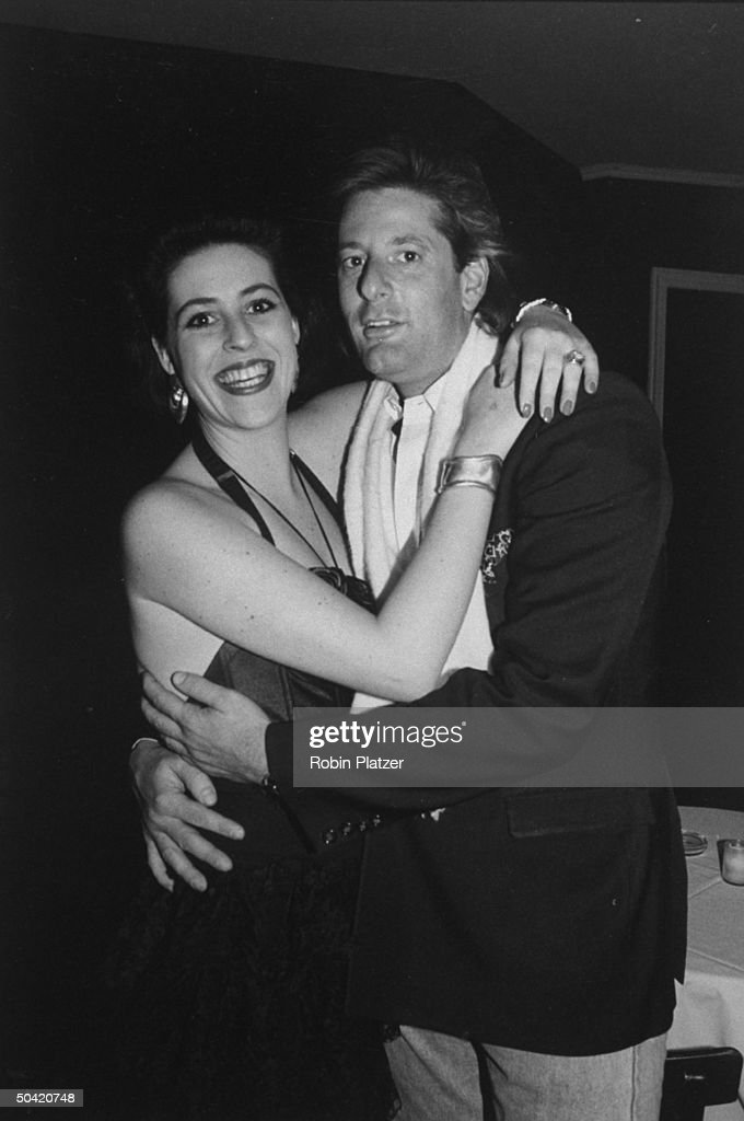 Ali Gertz, young woman w. AIDS virus, hugging an unident. man at her 24th birthday party at MK's night spot.