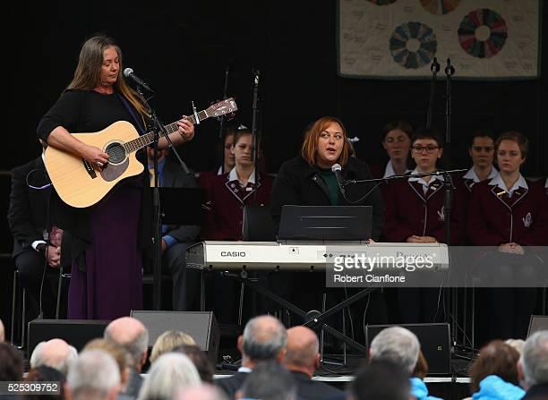 Ali Hart and Cait Vertigan perform during the 20th anniversary commemoration service of the Port Arthur massacre on April 28 2016 in Port Arthur...