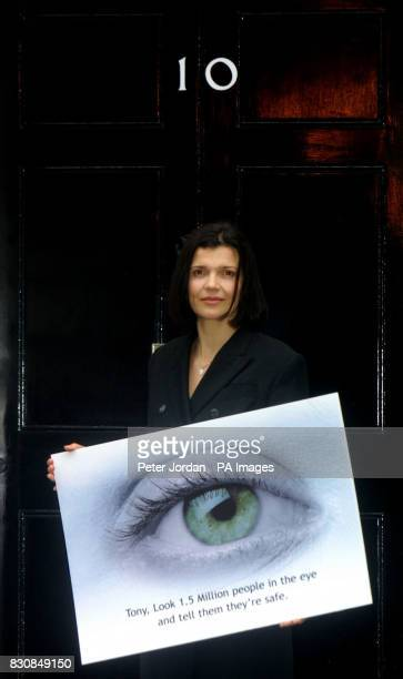 Ali Hewson wife of U2 singer Bono stands outside 10 Downing Street the official London residence of British Prime Minister Tony Blair with a giant...