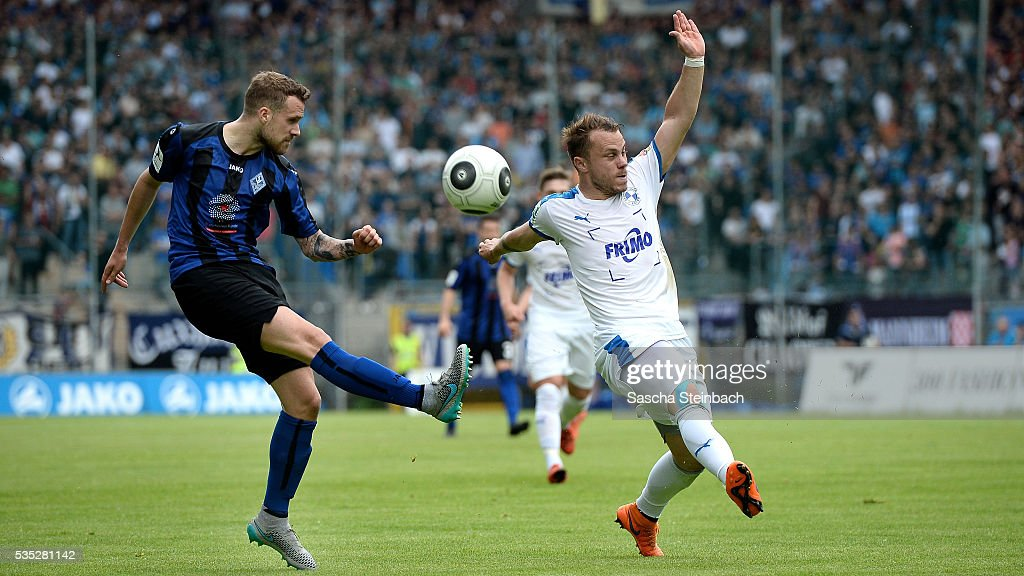 Ali Ibrahamaj of Mannheim and Nico Granatowski of Lotte battle for the ball during the 3. Liga playoff leg 2 match between Waldhof Mannheim and Sportfreunde Lotte at Carl-Benz-Stadion on May 29, 2016 in Lotte, Germany.