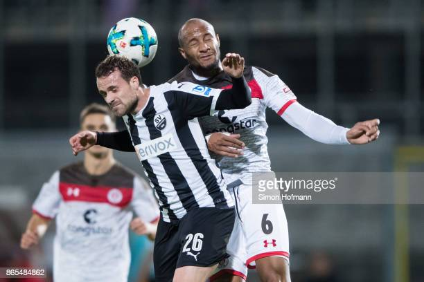 Ali Ibrahimaj of Sandhausen jumps for a header with Christopher Avevor of St Pauli during the Second Bundesliga match between SV Sandhausen and FC St...