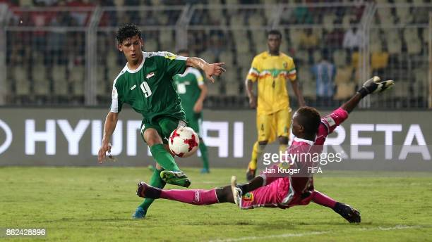 Ali Kareem of Iraq scores his teams opening goal during the FIFA U17 World Cup India 2017 Round of 16 match between Mali and Iraq at Pandit...