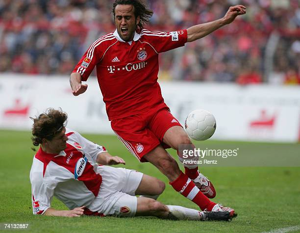 Ali Karimi of Munich vies for the ball with Steffen Baumgart of Cottbus during the Bundesliga match between Energie Cottbus and Bayern Munich at the...