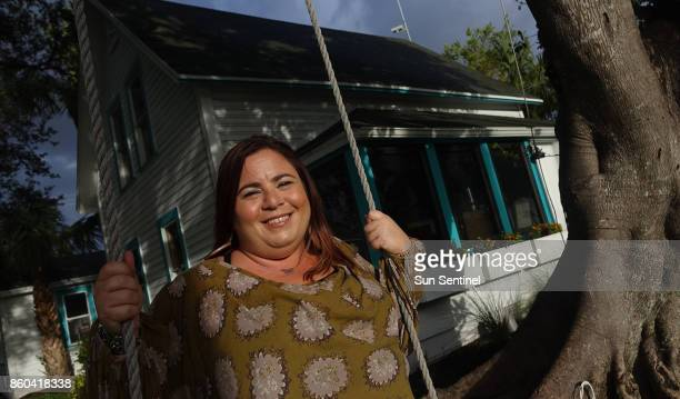 Ali Kaufman Space of Mind School founder and CEO is seen on a swing Wednesday Oct 4 on a tree in front of the old home that serves as the school