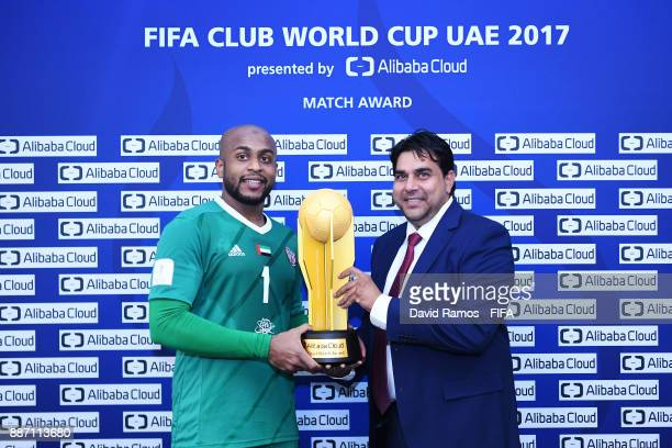 Ali Khaseif of AlJazira and Said Abu Sayeed Saleem Ceo of Yvolv pose with the Man of the Match trophy after winning the FIFA Club World Cup UAE 2017...