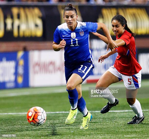 Ali Krieger of the United States is pursued by Sabine Chandler of Haiti during the second half of the US Women's 2015 World Cup victory tour match at...