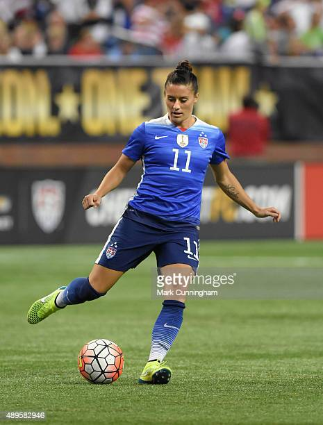 Ali Krieger of the United States passes the ball during the US Women's 2015 World Cup Victory Tour match against Haiti at Ford Field on September 17...