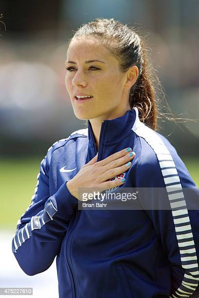 Ali Krieger of the United States stands for the national anthem before an international friendly match against Ireland on May 10 2015 at Avaya...