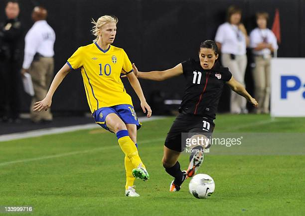 Ali Krieger of the US Women's National Soccer Team fights for the ball with Sofia Jakobsson of Sweden at University of Phoenix Stadium on November 19...