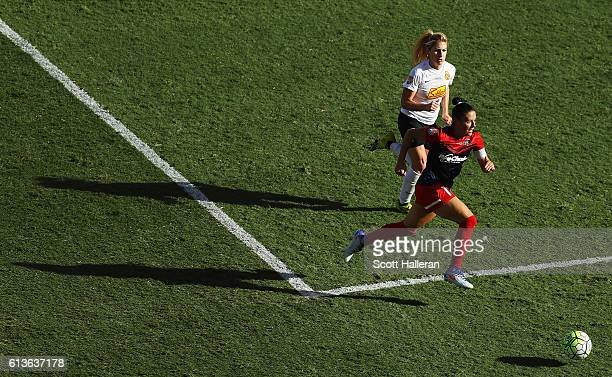 Ali Krieger of the Washington Spirit battles for the ball with McCall Zerboni of the Western New York Flash during the first half of the 2016 NWSL...