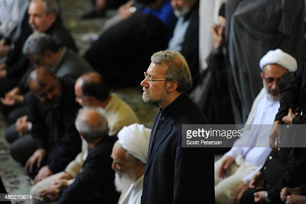 Ali Larijani Iran's parliamentary speaker and former nuclear negotiator stands during Friday Prayers during a Qods Day rally an annual proPalestinian...