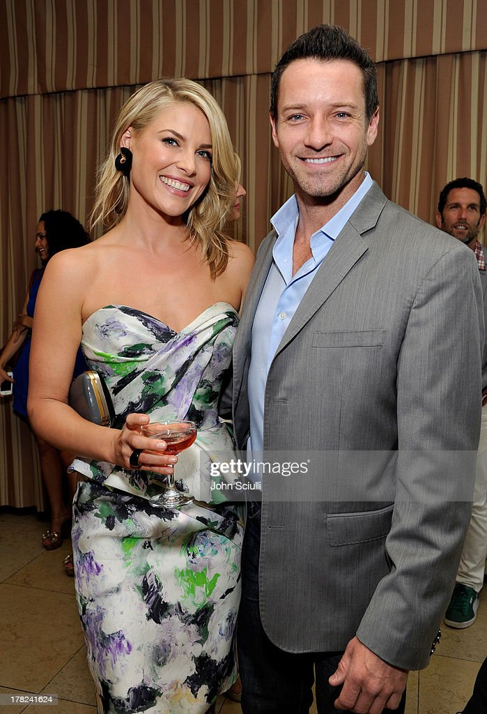 Ali Larter (L) and actor Ian Bohen celebrate the release of Ali Larter's new cookbook 'Kitchen Revelry' with Perrier-Jouet at Sunset Tower on August 27, 2013 in West Hollywood, California.