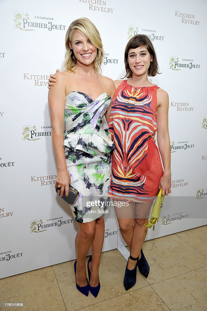 Ali Larter (L) and actress Lizzy Caplan celebrate the release of Ali Larter's new cookbook 'Kitchen Revelry' with Perrier-Jouet at Sunset Tower on August 27, 2013 in West Hollywood, California.