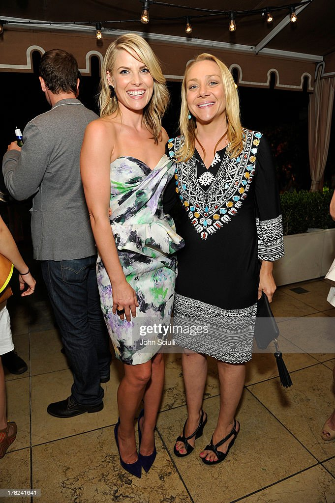 Ali Larter (L) and actress Nicole Sullivan celebrate the release of Ali Larter's new cookbook 'Kitchen Revelry' with Perrier-Jouet at Sunset Tower on August 27, 2013 in West Hollywood, California.
