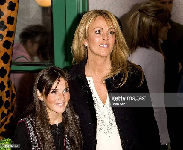 Ali Lohan with mom Dina during Ali Lohan Brings Christmas Cheer to Kids with Cancer at the Ronald McDonald House December 7 2005 at Ronald McDonald...