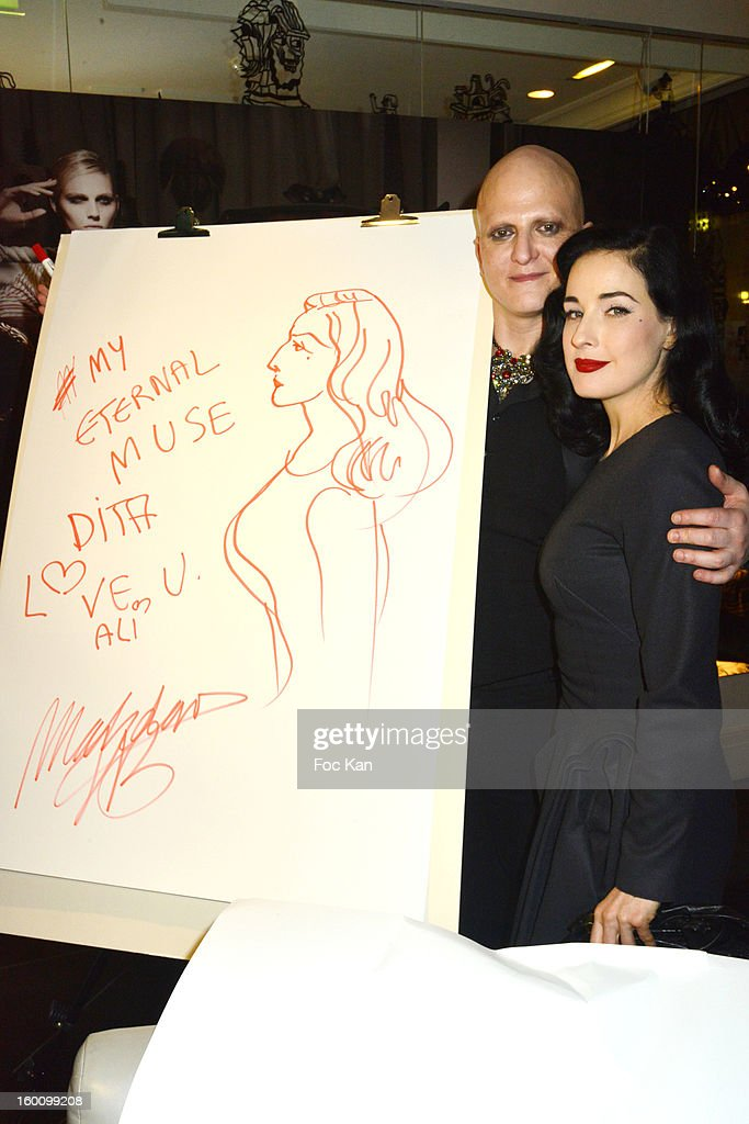 Ali Mahdavi and <a gi-track='captionPersonalityLinkClicked' href=/galleries/search?phrase=Dita+Von+Teese&family=editorial&specificpeople=210578 ng-click='$event.stopPropagation()'>Dita Von Teese</a> attend the 'Body Double' Ali Mahdavi Exhibition Preview Cocktail At Hotel W on January 25, 2013 in Paris, France.