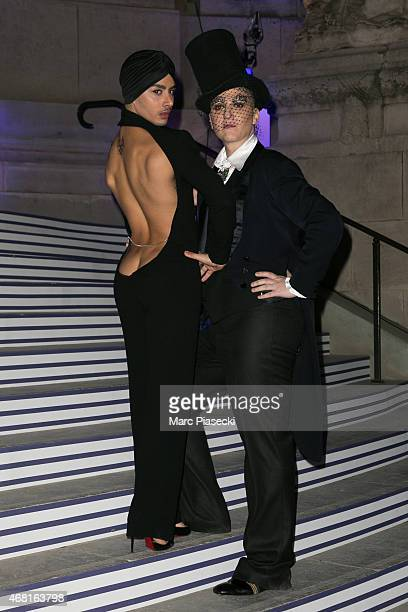 Ali Mahdavi and guest attend the 'Jean Paul Gaultier' exhibition opening cocktail at Grand Palais on March 30 2015 in Paris France