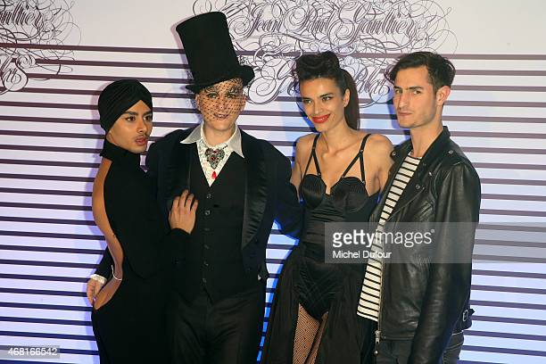 Ali Mahdavi and Marie Meyer attend the 'Jean Paul Gaultier Exhibition' Photocall At Grand Palais at Grand Palais on March 30 2015 in Paris France