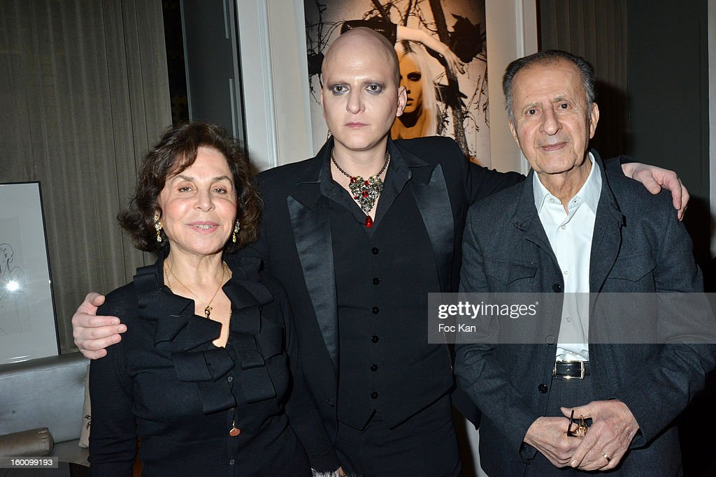 Ali Mahdavi (C) beetween his mother and his father attend the 'Body Double' Ali Mahdavi Exhibition Preview Cocktail At Hotel W on January 25, 2013 in Paris, France.