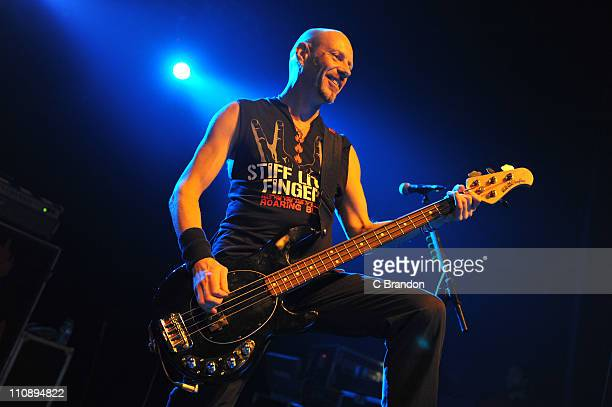 Ali McMordie of Stiff Little Fingers performs on stage at HMV Forum on March 25 2011 in London England