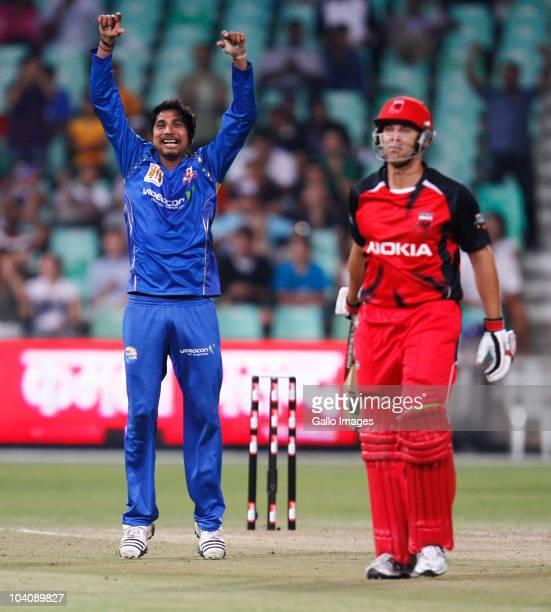 Ali Mortaza of Mumbai Indians celebrates a wicket during the Airtel Champions League Twenty20 match between Mumbai Indians and South Australian...