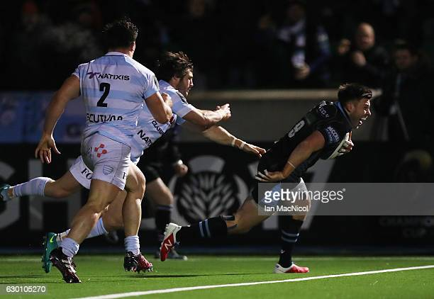 Ali Price of Glasgow scores the third try of the game during the European Rugby Champions Cup match between Glasgow Warriors and Racing 92 at...