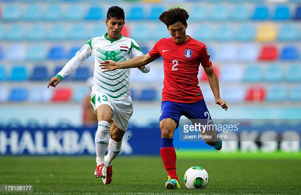 Ali Qasim of Iraq and Sim Sangmin of Korea Republic compete for the ball during the FIFA U20 World Cup Quarter Final match between Iraq and Korea...