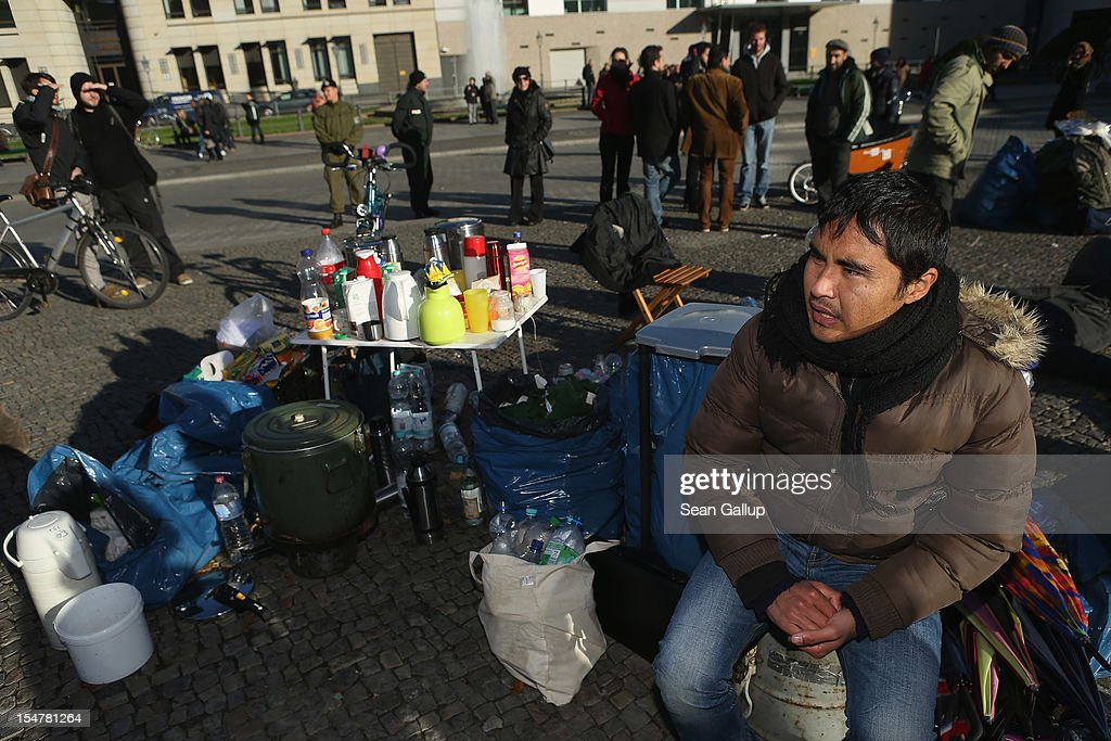 Ali Rez Merzai, a refugee from Afghanistan who arrived in Germany in 2010, sits with other refugees undertaking a hunger strike in front of the Brandenburg Gate on October 26, 2012 in Berlin, Germany. The demonstrators, predominantly from Iran, Afghanistan and Iraq, are subsisting on only water, tea and coffee without sugar. They have been sitting in front of the Brandenburg Gate since October 24, and say they will continue their strike until the German government responds to their demands for a halt to deportations and faster processing of asylum applications.