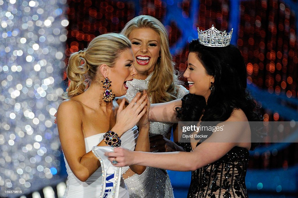 Ali Rogers, (C) Miss South Carolina, looks on as Miss America 2012 Laura Kaeppeler (R) congratulates Mallory Hytes Hagan of New York, after being crowned the new Miss America during the 2013 Miss America Pageant at PH Live at Planet Hollywood Resort & Casino on January 12, 2013 in Las Vegas, Nevada.