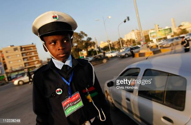 Ali Salem elFaizani stands at a street corner while working as a traffic cop April 15 2011 in Benghazi Libya Schools have been closed throughout...